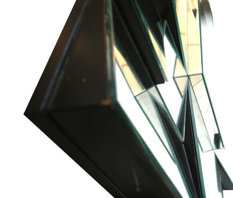 Fantastic slopes mirror designed by Neal Small in a black wood frame.