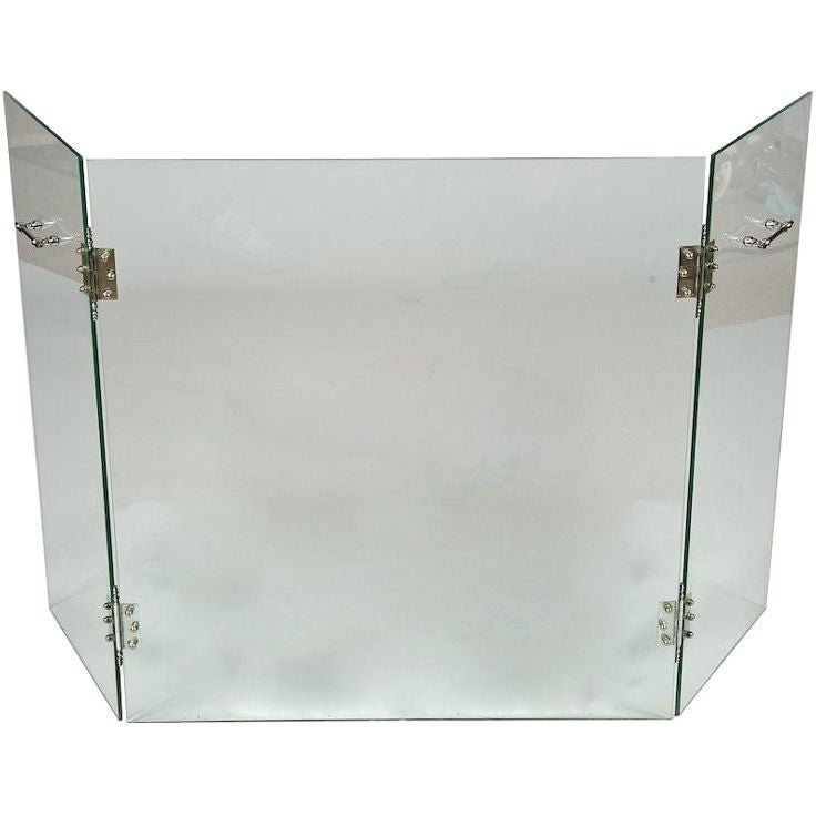 mid century glass fireplace screen with polished nickel hardware at