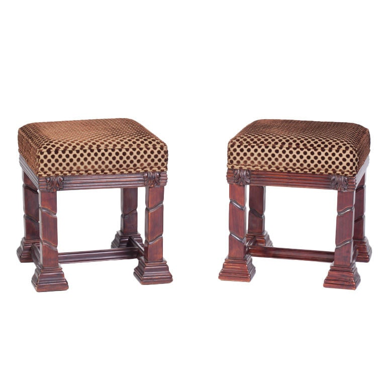 Pair of carved shell motif ottomans at stdibs