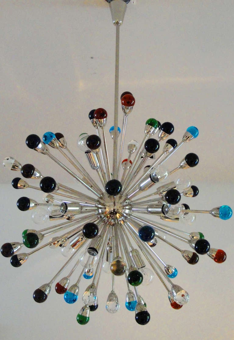 Large Sputnik chandelier with 16 light sockets and 57 rods of two lengths ending with different color glass spheres.