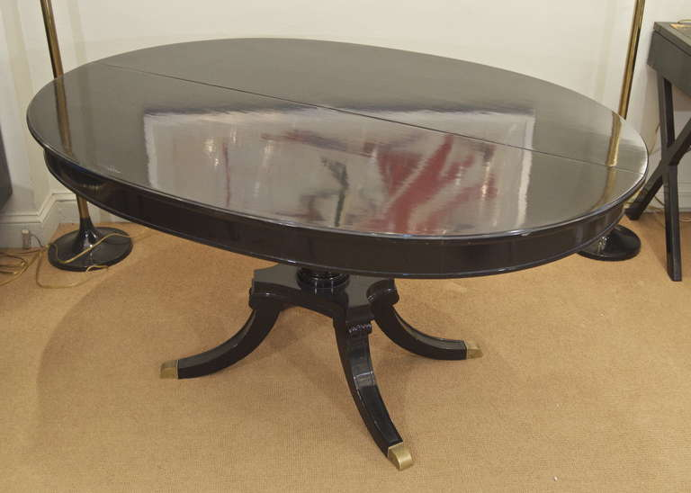 jansen black lacquer oval dining table with flip top at