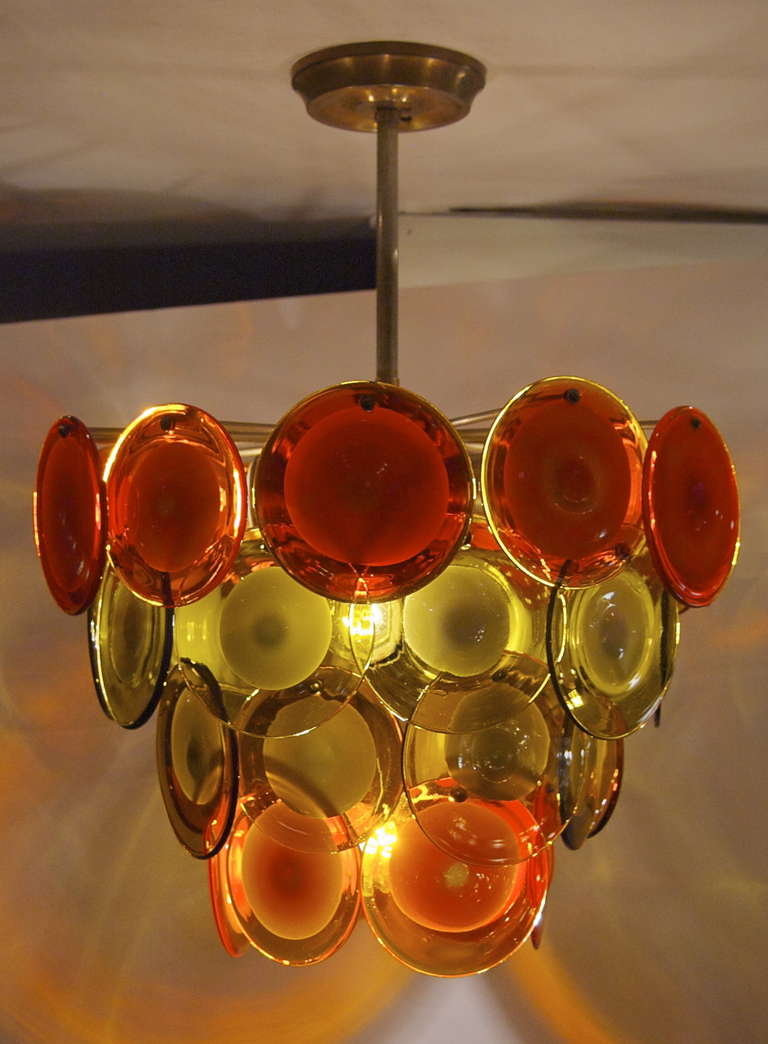 Vistosi four tiered amber and orange disc chandelier at 1stdibs this original vistosi chandelier features four tiers of alternating redorange and ambergreen aloadofball Image collections