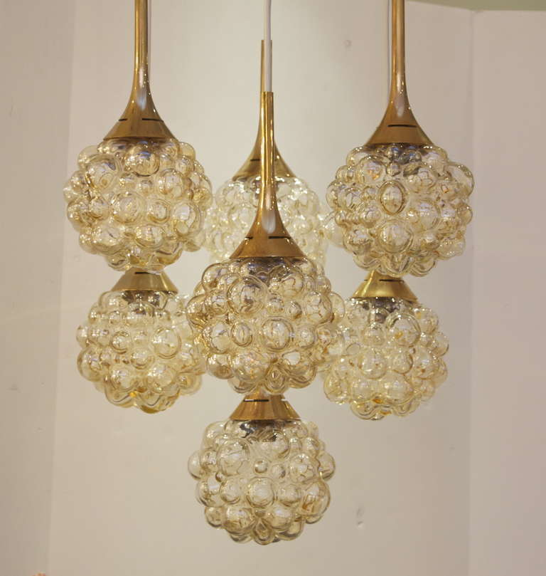 Mid-20th Century Amber-Tone Bubble Pendant Chandelier with Brass Accents For Sale