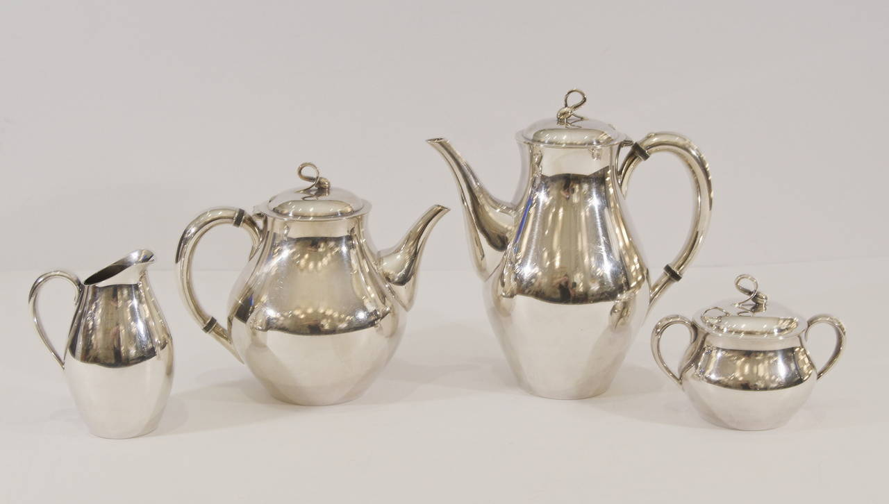"""""""Americana"""" pattern coffee & tea silver-plate service for Reed & Barton.  Includes tea and coffee pots, sugar bowl with lid and cream pitcher.  Dimensions given are of coffee pot (taller)."""