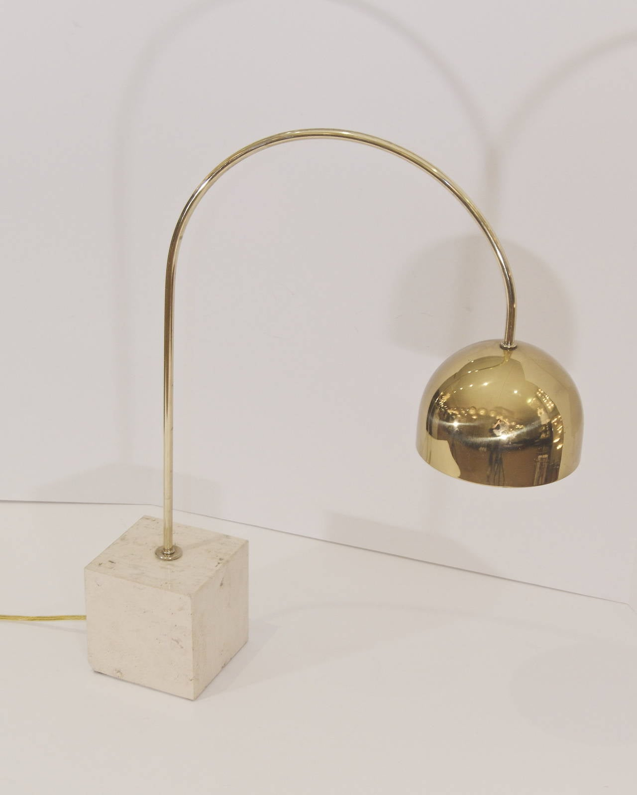 Italian Guzzini Brass Arc Table Lamp With Travertine Base For Sale