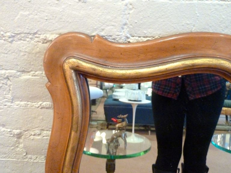 Generous scalloped fruitwood mirror with gilt accents by Widdicomb. Will enhance all decors. Unsigned.