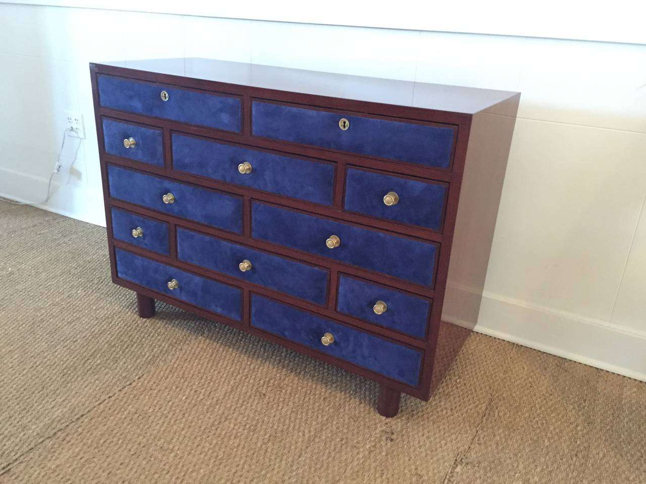 Rare 12 drawers clad with vibrant and rich Midnight Blue suede, -newly replaced Suede - all original hardware (gold-plated pulls). Polished mahogany base. Just breathtaking.