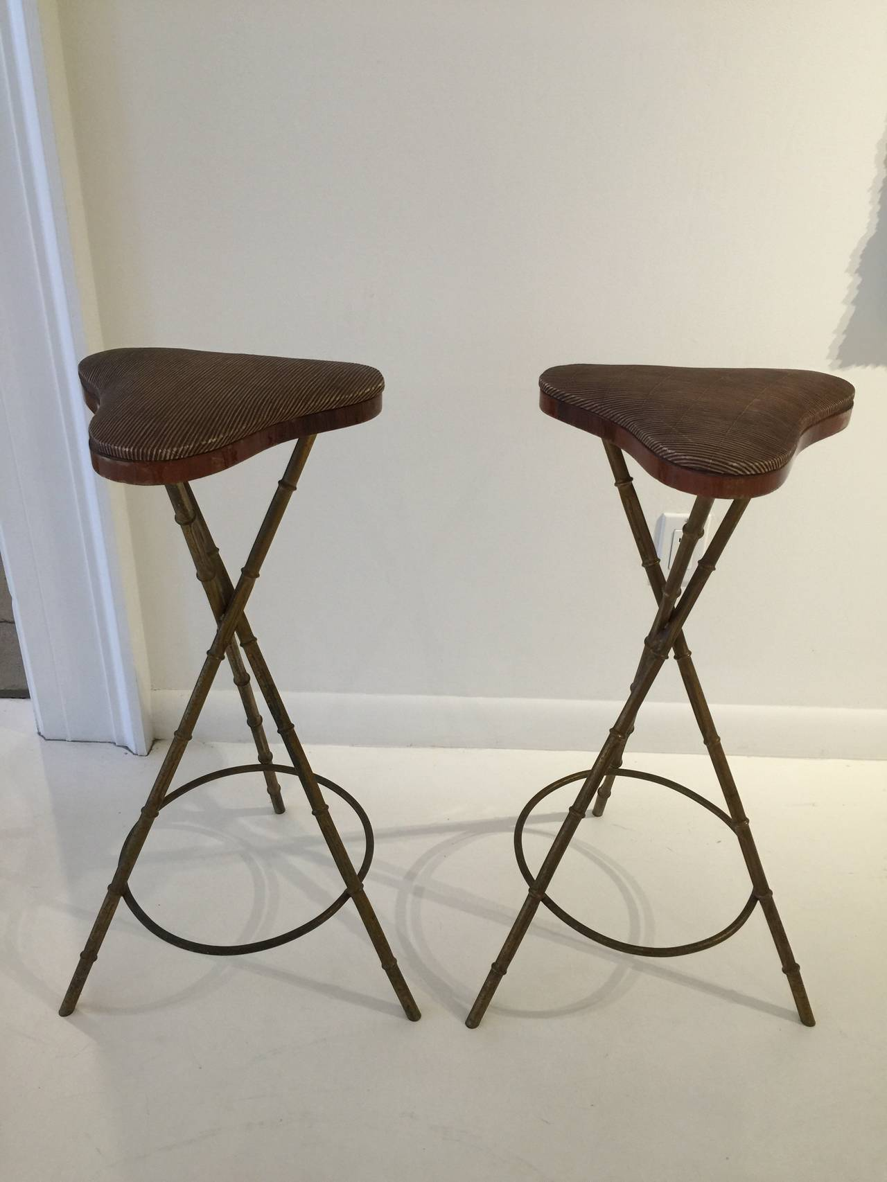 Designed by jacques adnet this pair of gilt metal bamboo style bar stools are all