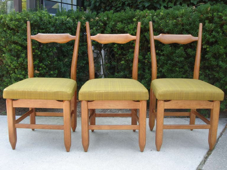 Beautifully carved backrests, original upholstery. Sturdy and great country chic look.