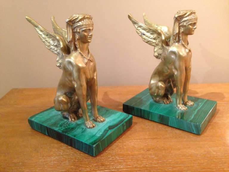 Mounted on real Russian malachite bases, these Egyptian mythological creatures are heavy and truly a conversation piece.