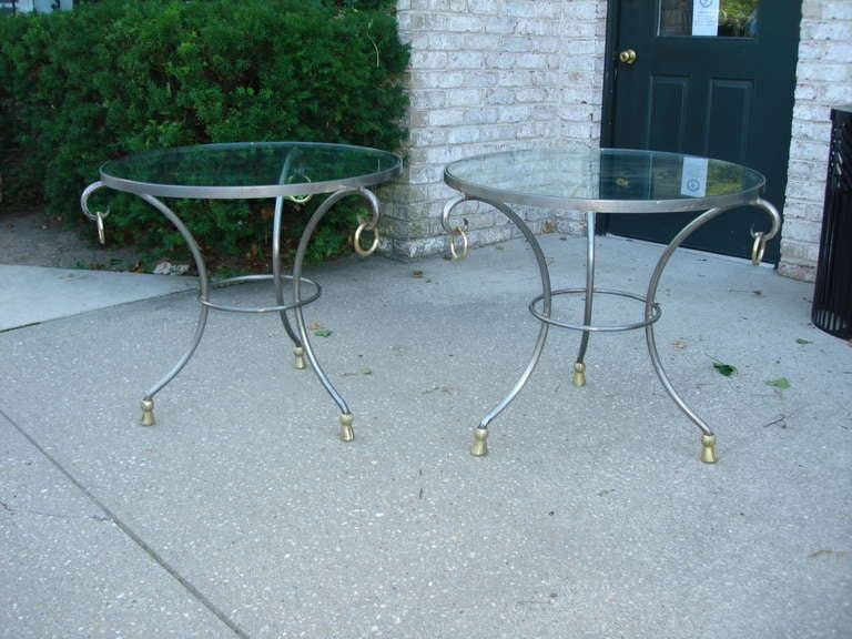 Adorned with brass rings and tasselled sabots, these steel gueridon side tables are exquisitely stylish. Showing appropriate patina and wear - very stylish and desirable.