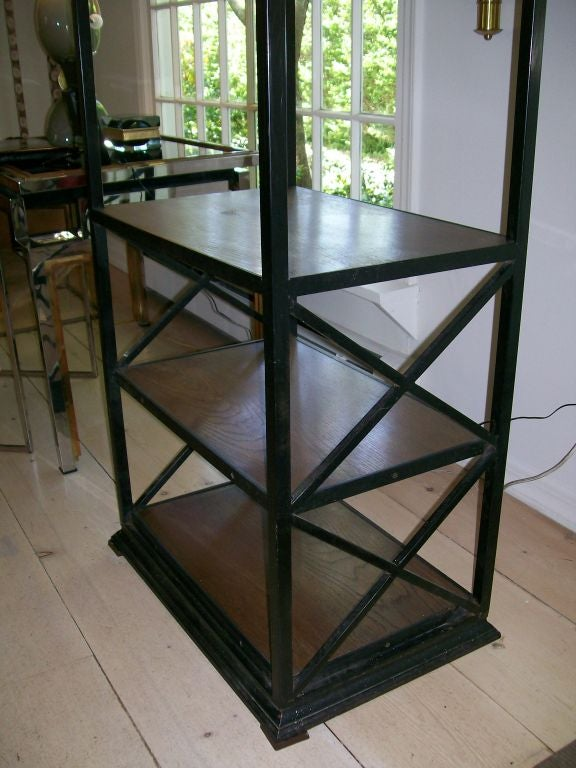 Very heavy and well designed, this iron and wood ètagerè features X-frame sides. This is very tall, approximately 8 feet and in wonderful vintage condition.