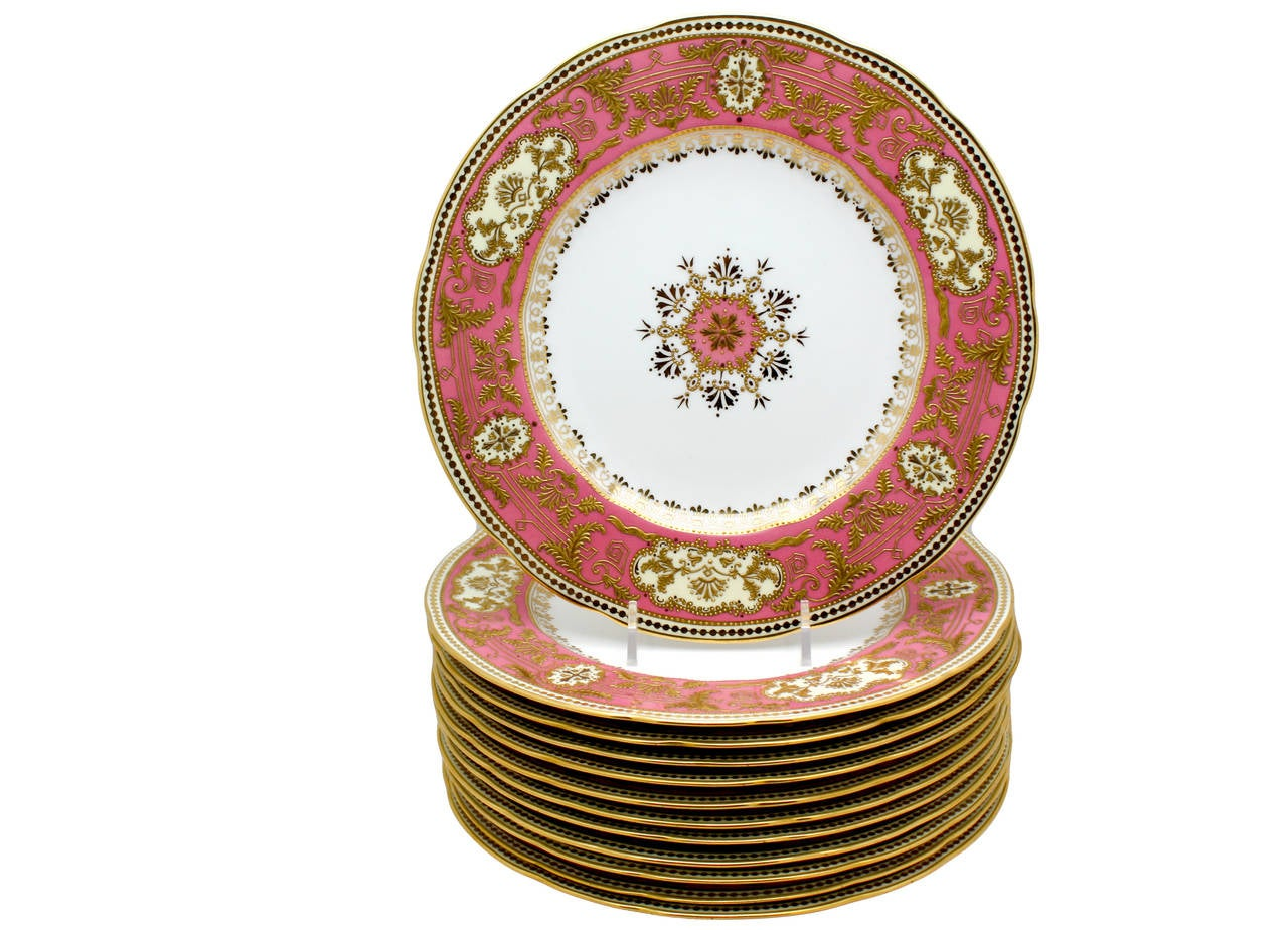 This is an exquisite set of Spode Copelands dessert plates made exclusively for Tiffany's, with all the bells and whistles. The