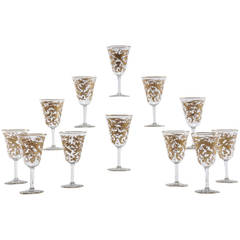 12 Baccarat Crystal Wine Goblets Intaglio Cut with Gilded Exotic Bird Motifs