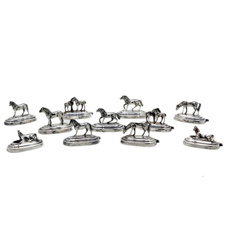 Eleven silver horse place-card holders, 1920s