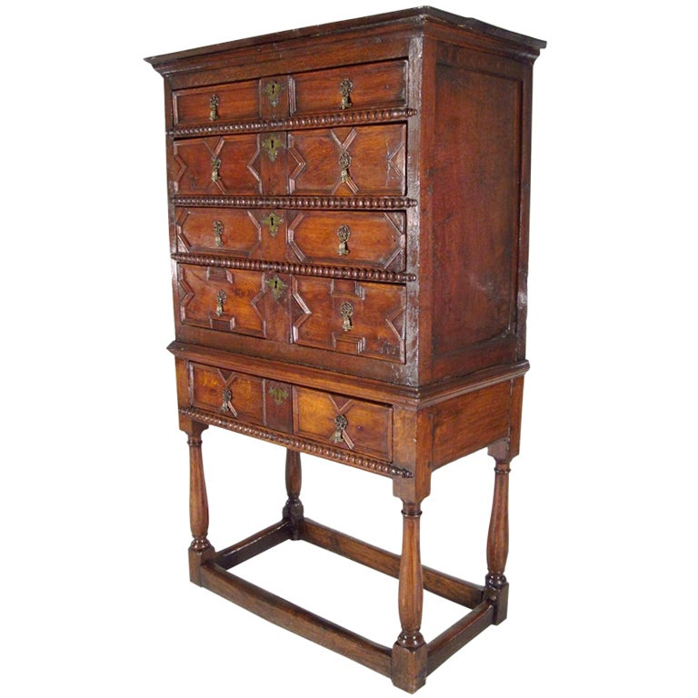 Jacobean oak chest on later stand, English late 17th/early 18th c., case fitted with four graduatead drawers, on stand with balustered supports with block stretchers.