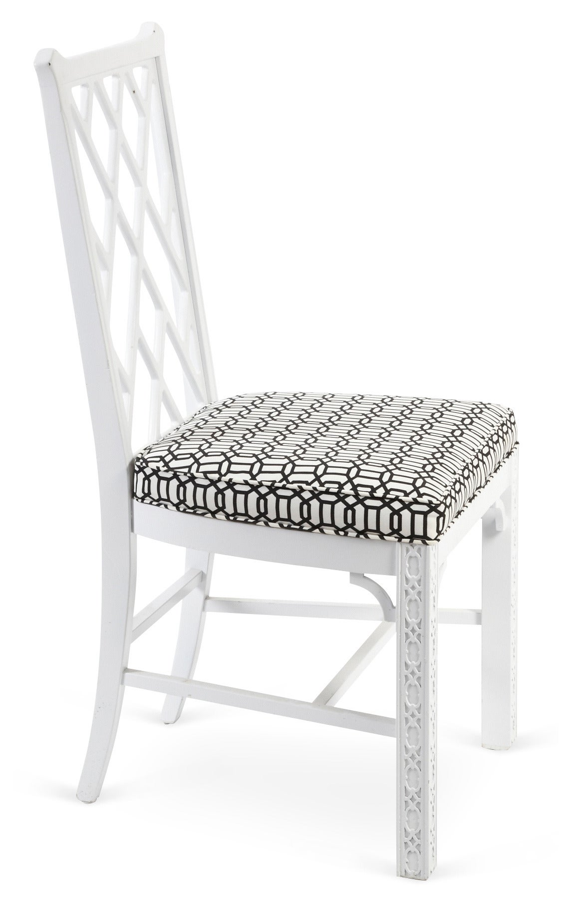Pair of vintage side chairs with fretwork-style backs. Legs have stunning carved incised detailing. Black-on-white linen seats. Solid construction.