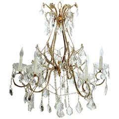 Regency Style Gilt And Crystal Eight Light Chandelier At