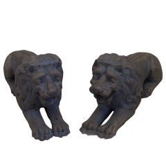 Pair of Carved Lions Couchant
