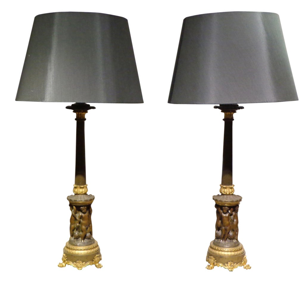 A Fine Pair of Louis Philippe Patinated & Gilt Bronze Candelsticks, now as Lamps