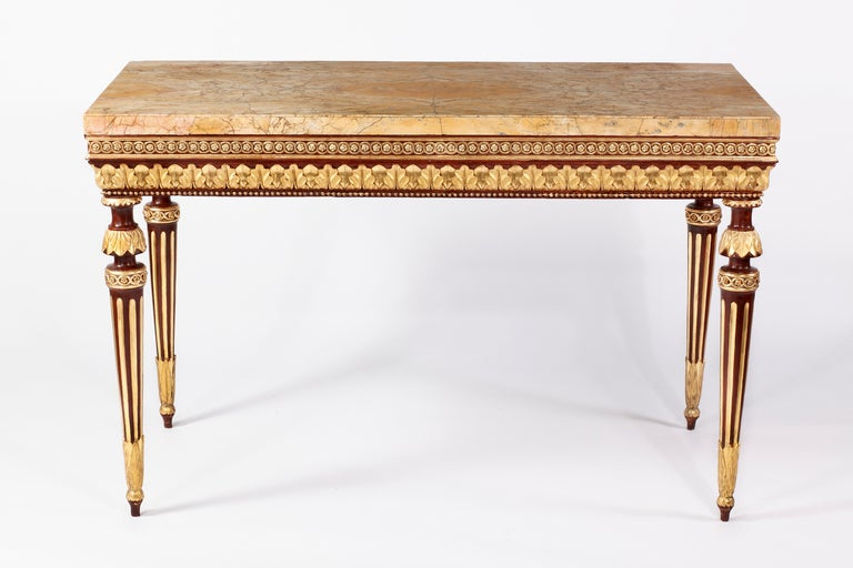 An Important Neoclassical  Lacquered & Parcel Gilt Console Florence, Italy 18th Century  The spetacular & wonderful sienna veneered marble top above the conforming frieze with carved guilloche and leaf tip decoration, raised on waisted