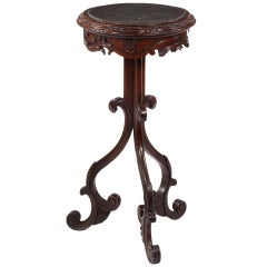 An American Carved Walnut Stand