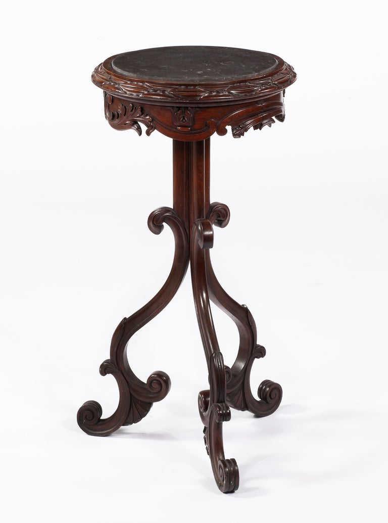 An American Carved Walnut Stand With Marble Top Mid 19th Century   The circular top carved with foliage with a marble insert on a tripod base ending in scrolled feet  Height 34 in.  Diameter 17 in.  Private Collection, Boston, MA. Le Trianon Fine