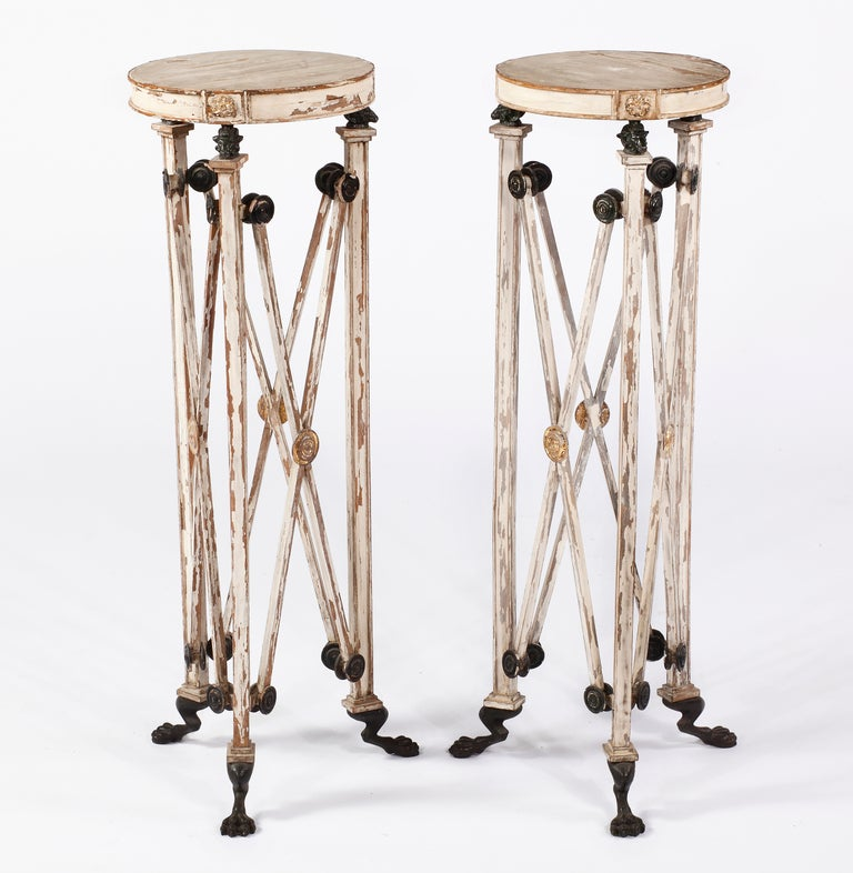 A Fine Pair of Painted & Partial Gilt  Bronze Mounted Pedestals Early 19th Century  England  Each pedestal with a circular top with gilt mounted rosettes over bronze ram heads, over three legs with joining x-strectchers with several round