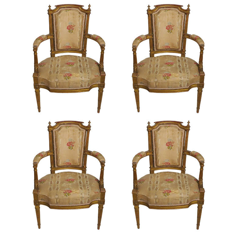 fine set of four louis xvi giltwood fauteuils by georges. Black Bedroom Furniture Sets. Home Design Ideas