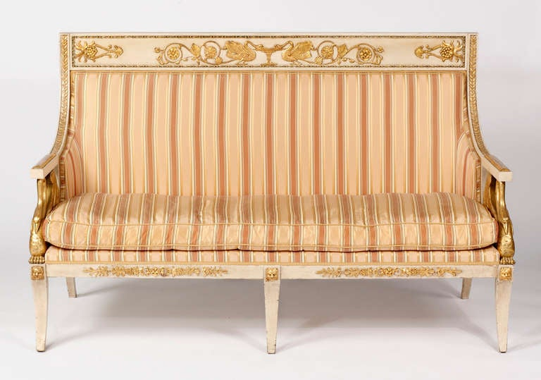An Important Italian Neoclassical Painted & Parcel Gilt Canapé  First Quarter 19th Century Lombardy, Italy  The back rest with paneled top rail decorated with swans flanking a fountain, the wooden armrests raised on swan-shaped supports, the