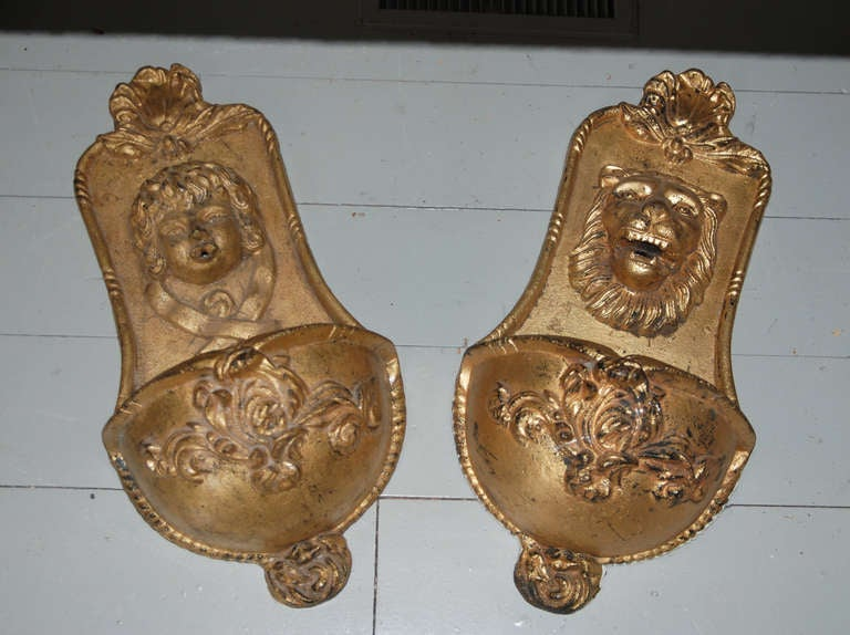 A Pair of Gilt Cast Iron Wall Fountains 19th Century  Height 26 in  Width 13 in.  Provenance: Property of the estate of Actress Syvia Sydney,LA  Arc119 $2,800