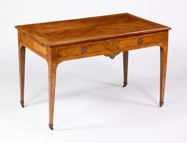 A Louis XVI Kingwood & Tulipwood Inlaid Writing Desk with Bronze mounts Late 18th Century  The rectangular top over two drawers and two pullouts, all on tapering legs ending in sabots  Height 29 in.  Width 46 in.  Depth 27 in.   Desk