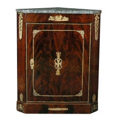 A French Empire Mahogany Corner Cabinet with Ormolu Mounts