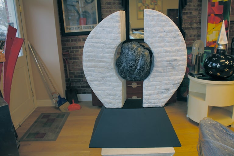 A wonderful large-scale and quite heavy three-dimensional fitted marble and steel sculpture. The base is steel and the two sides slip into slots in the base as the middle ball is held by rods as well into the sides. The center ball has been