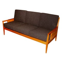 Beautiful caned and upholstered sculptural sofa