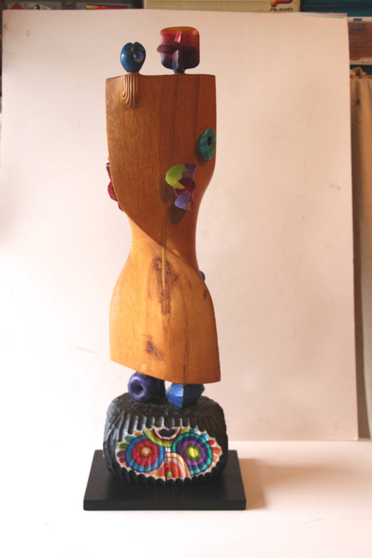 A wonderful wood sculpture by the noted NJ artist Fred Scumm. It is inscribed near the base with no date. Likely from the late 1980s or early 1990s. Colorful and whimsical. The artist statement follows from a 2007 article; Fred Schumm does not view