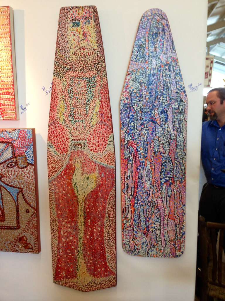 Two painted ironing boards by the noted Woodstock ny artist Michael Heinrich. One of the boards is monogrammed mh.  These are acrylic on much older  wood ironing boards. These are wonderful pieces done in Heinrich pointillist style of outsider folk