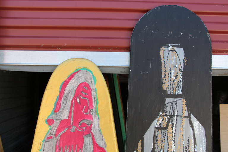 2 matched painted ironing boards by the noted Woodstock artist Michael Heinrich. He is a self-taught outsider artist and paint in a graffiti style. These two boards seems to represent a couple. One is signed with his signature logo MH? The other has
