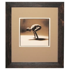 Sepia Toned Photograph of a Woman in a Yoga Position