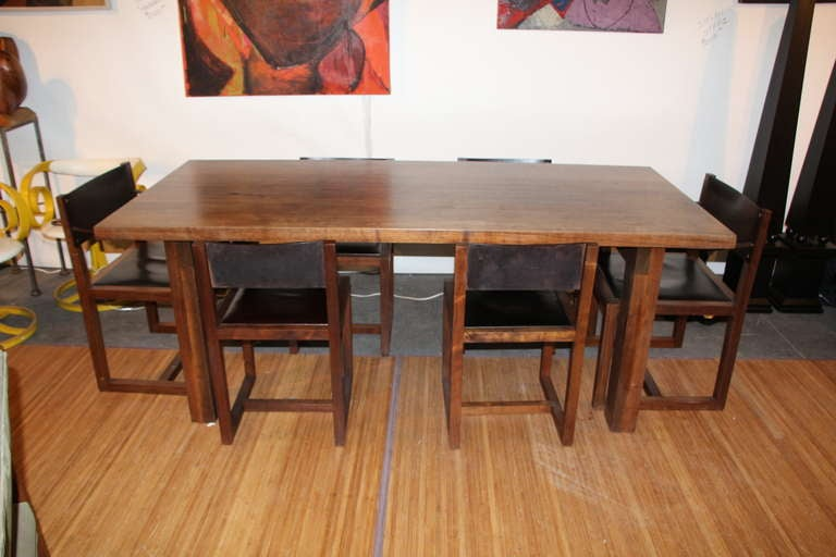 A beautiful and solid walnut and leather dining or kitchen set. This company founded by Tyler Hayes makes only the best in custom furniture and is considered one of the best custom makers in the trade. The company guarantees it's work and has