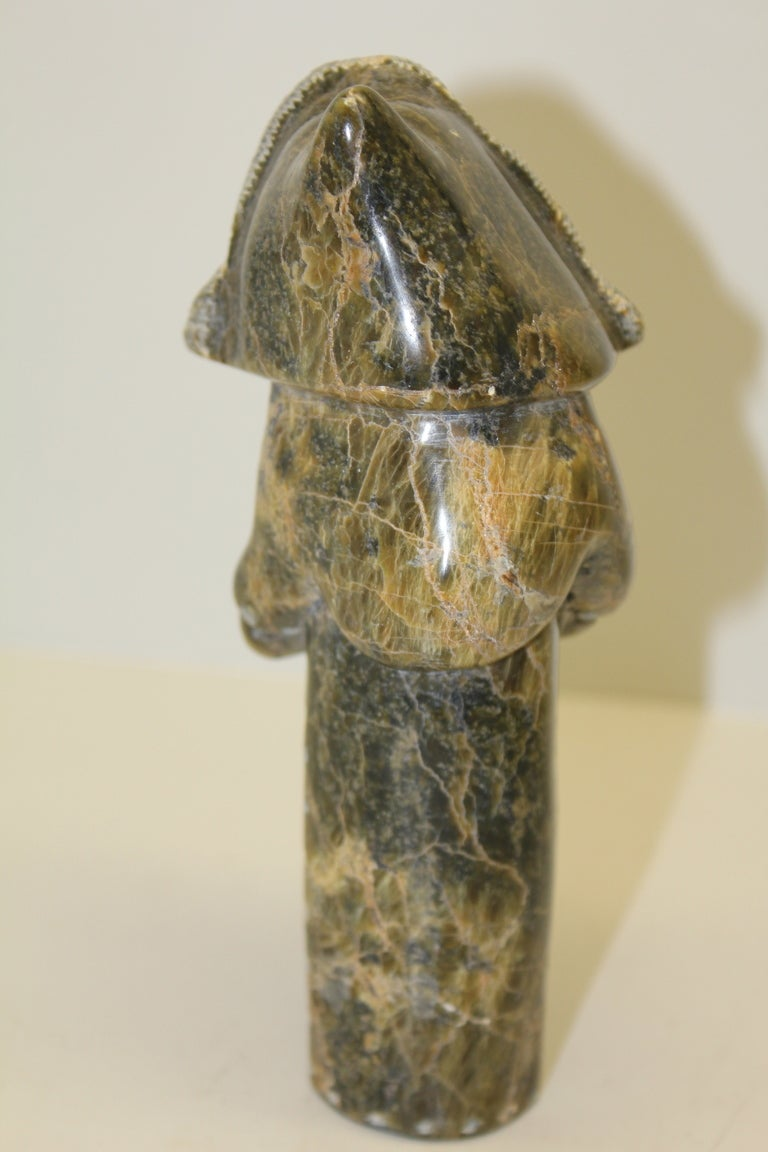 Two eskimo inuit carvings of women wearing amauti by