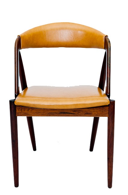 Set of six rosewood Kai Kristiansen dining chairs. NOTE: Chairs have been reupholstered since photo was taken.   Store formerly known as ARTFUL DODGER INC