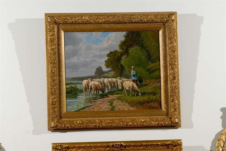A French Barbizon school painting of a herd of sheep with shepherd and dog by French artist Pablo Martinez Del Rio from the late 19th century in giltwood frame. This French Barbizon plein-air painting features a shepherd and his dog leading a herd