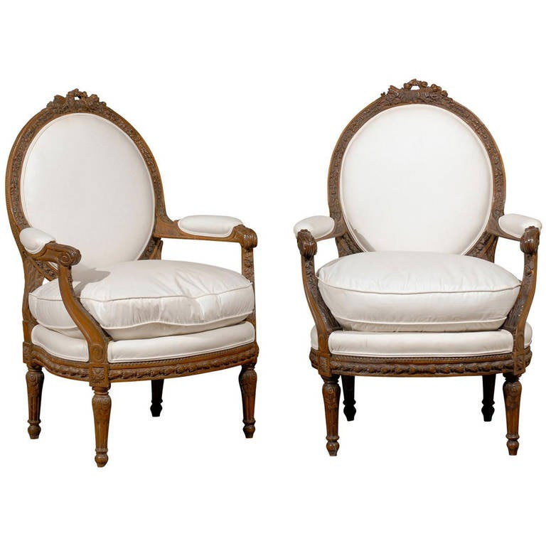 Pair of French Louis XVI Style Upholstered Armchairs from the Early 19th Century