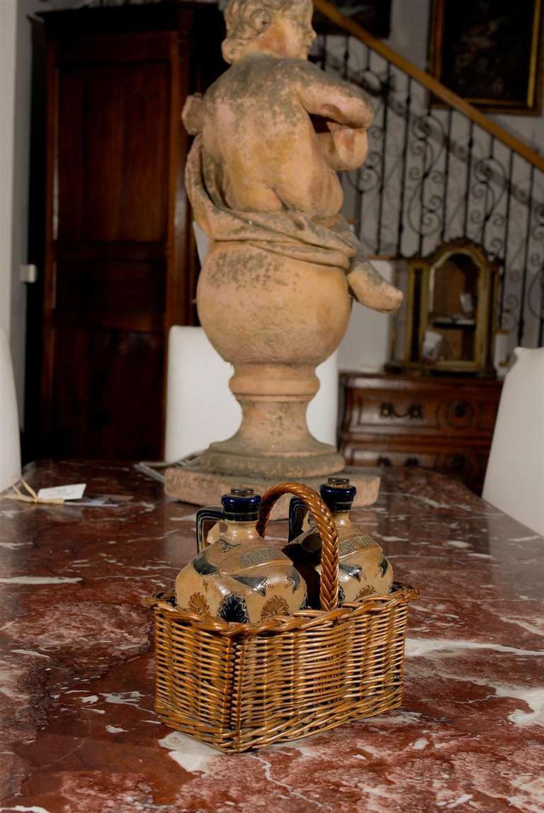 Two Victorian English Pottery Decanters in Tantalus-Inspired Wicker Basket In Good Condition For Sale In Atlanta, GA