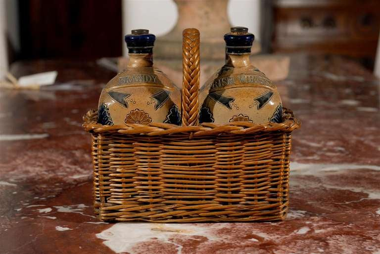 Two Victorian English Pottery Decanters in Tantalus-Inspired Wicker Basket For Sale 2