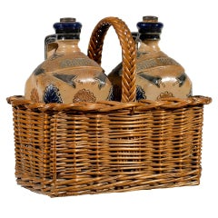Two Victorian English Pottery Decanters in Tantalus-Inspired Wicker Basket