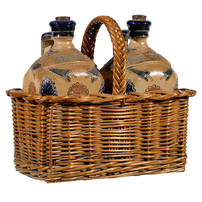 Two Victorian English Pottery Decanters in Tantalus-Inspired Wicker Basket For Sale