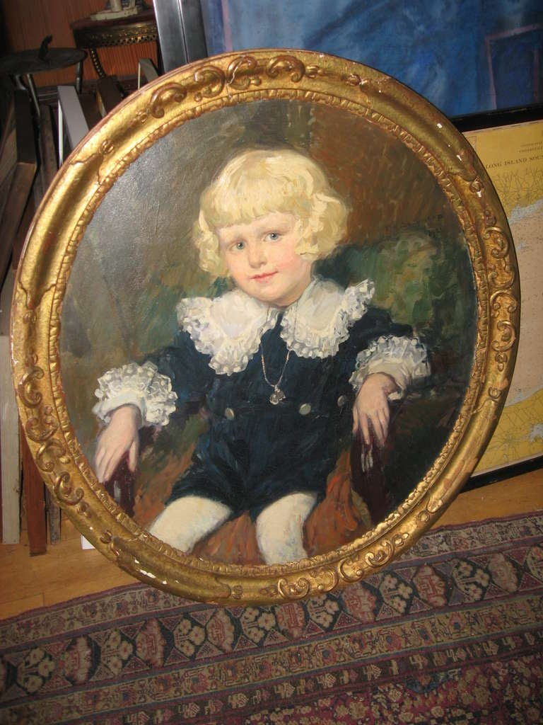 19th century painting of a young boy in a giltwood frame.