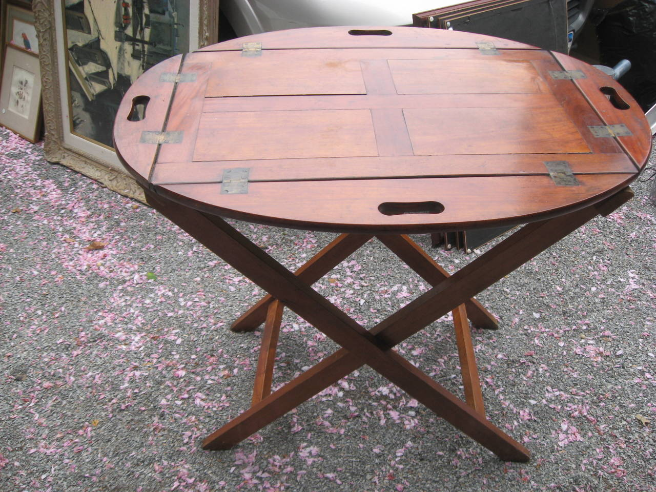 19th century English mahogany butlers tray table on a bar height stand with brass hinges.